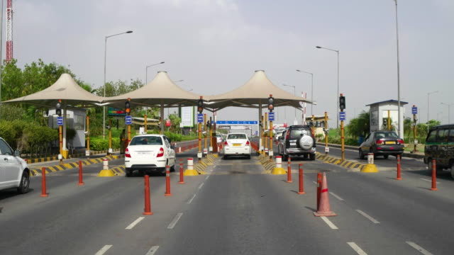 Exiting the International Airport terminal T3 at IGIA, T/L POV of car