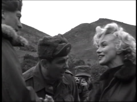 / exits helicopter soldiers help lift her on top of tank she waves to the surrounding soldiers - 1954 stock videos & royalty-free footage