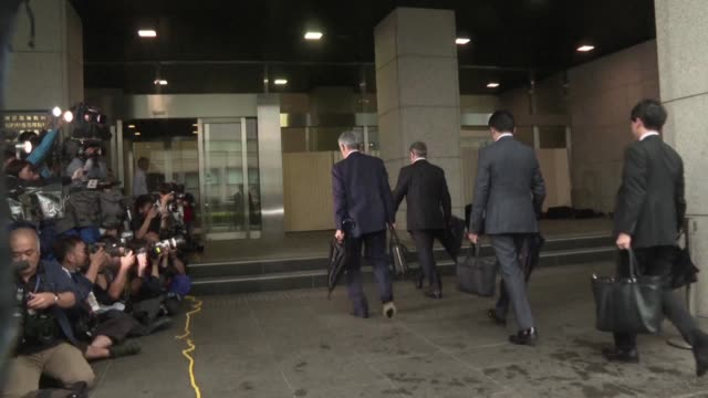 exnissan chief carlos ghosn arrives with his defence lawyers at the tokyo district court monday for a pre trial hearing - court hearing stock videos and b-roll footage
