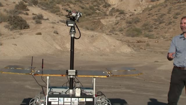 exomars prototype rover taken for test drive in spanish desert; spain; ground station workers typing commands / space rover in desert. spain: int... - probe stock-videos und b-roll-filmmaterial