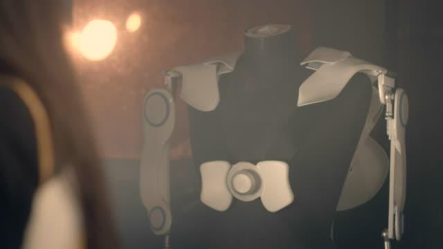 exoskeleton project. woman making last adjustments - exoskeleton stock videos & royalty-free footage