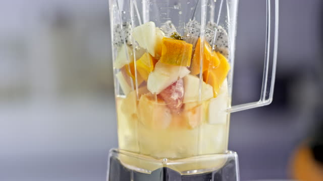 exotic fruit smoothie mixing in the blender - mango stock videos & royalty-free footage