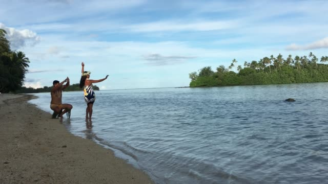 exotic pacific islander man and woman dancing at muri lagoon in rarotonga cook islands - pacific islander stock videos & royalty-free footage