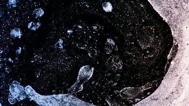 expanding mass particles in swirl and explosive organic forms space cosmic matter growing structures grunge style intro background for detective series - volume fluid capacity stock videos & royalty-free footage