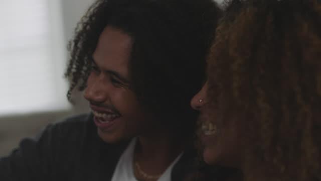 vídeos de stock e filmes b-roll de expecting african-american couple announce pregnancy over voice chat - rir