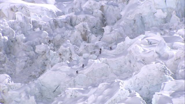 climbers on khumbu icefall more of climbers on khumbu icefall pull out - icefall stock videos and b-roll footage