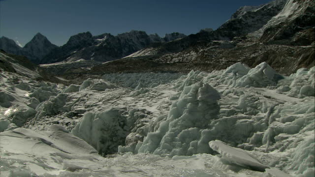 khumbu icefall climber pulling in rope on khumbu icefall / general views of khumbu icefall / ice glittering in the sun / climbers pull out pan... - icefall stock videos and b-roll footage