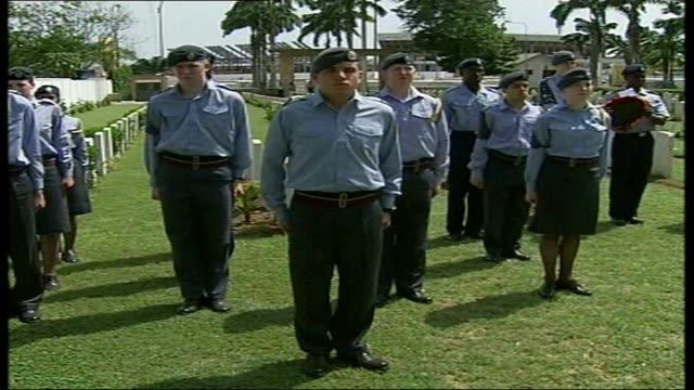 vídeos de stock e filmes b-roll de raf cadets work on school renovation in accra raf cadets marching to cemetery to pay respects to commonwealth soldiers who fought in world war ii and... - cadete