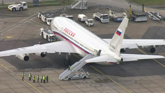 Expelled Russian diplomats leave the aerials of plane departure AIR VIEWS Russian government plane on tarmac / plane taxiing on runway