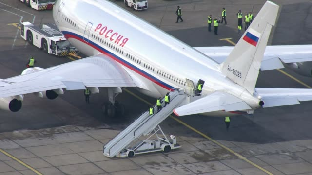 expelled russian diplomats leave the aerials of plane departure england essex stansted russian government plane 'poccnr' on tarmac - botschafter stock-videos und b-roll-filmmaterial