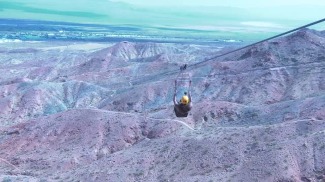 experience the bootleg canyon zip line tour by flightlinez in las vegas, nevada. - red rocks stock videos & royalty-free footage