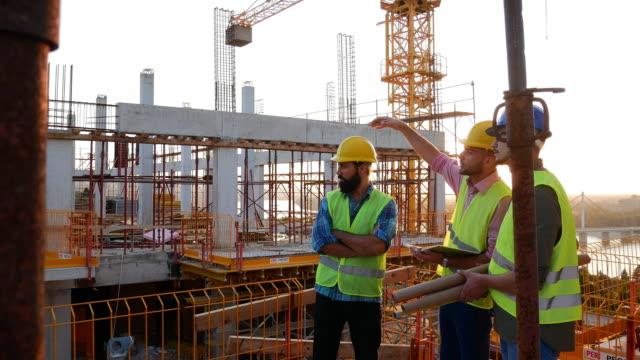 Experienced engineers working on the construction site