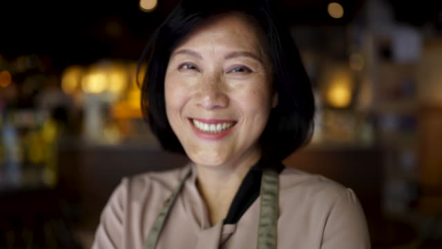 experienced in running her business - asian stock videos & royalty-free footage