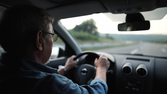experienced older man with glasses drives a car - senior men stock videos & royalty-free footage