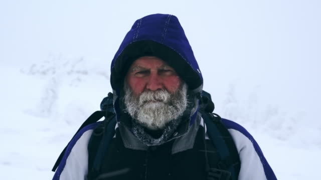 Experienced winter hiker in snowstorm