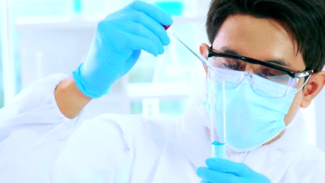 experiment at science laboratory - safety glasses stock videos & royalty-free footage