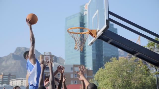 Expert basketball player scoring a slam dunk