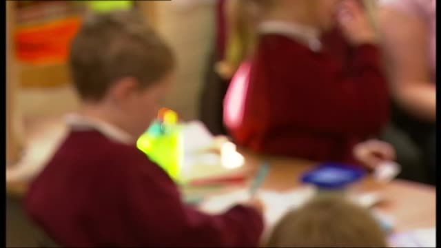 experts claim 'fat letters' to parents should be scrapped t04091238 / tx various of anonymous children in nursery school classroom various of... - anonymous stock videos and b-roll footage