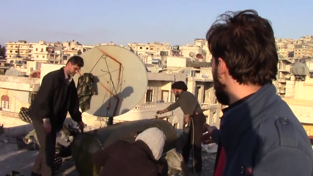 Experts from Free Syrian Army try to destroy Russian ballistic missile which didn't explode during an attack in February in Idlib Syria on March 07...