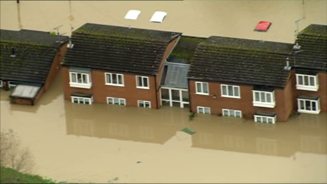 experts meet at the met office to discuss causes of recent unusual weather lib / denbighshire st asaph of flooded street and partially submerged... - buried stock videos & royalty-free footage