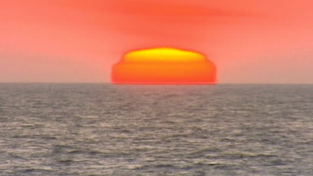 experts on time debate whether to abolish the leap second; east anglia: speeded up time lapse sequence sun rising over the north sea - east anglia stock videos & royalty-free footage