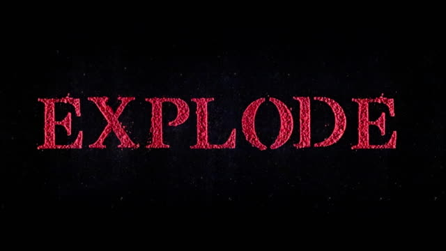 Explode written in red powder exploding in slow motion.