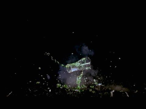 Exploding beaker containing green liquid