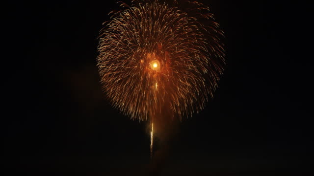 exploding fireworks in japan, low angle - firework display stock videos & royalty-free footage