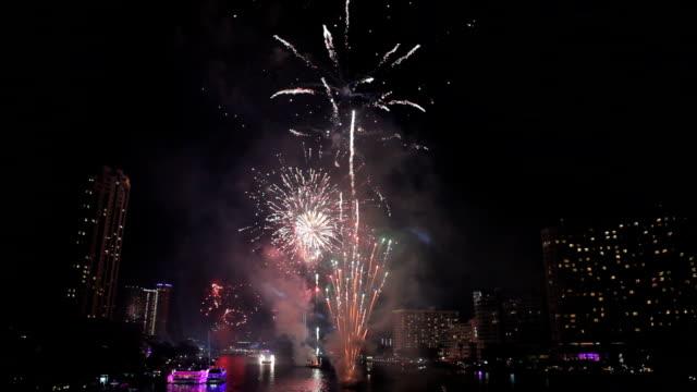 Exploding fireworks over chaophraya river in bangkok Thailand