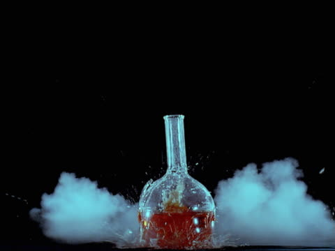 exploding glass beaker containing red liquid - beaker stock videos & royalty-free footage