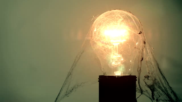 Exploding light bulb & cobweb