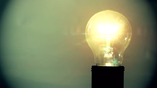 exploding light bulb - vignette stock videos & royalty-free footage