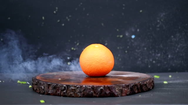 exploding orange fruit - 4k resolution - single object stock videos & royalty-free footage