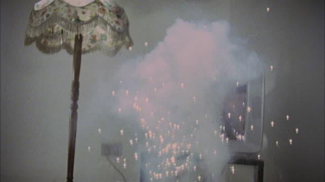 vídeos de stock e filmes b-roll de slo mo, ms, exploding television - sala de casa