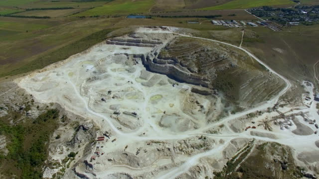 aerial: exploration and production of granite rubble - quarry stock videos and b-roll footage