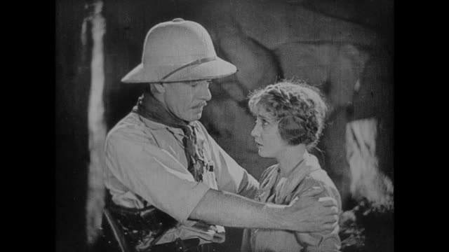 1925 explorer comforts woman after handing her pocket watch and giving her bad news - 1925 stock videos & royalty-free footage