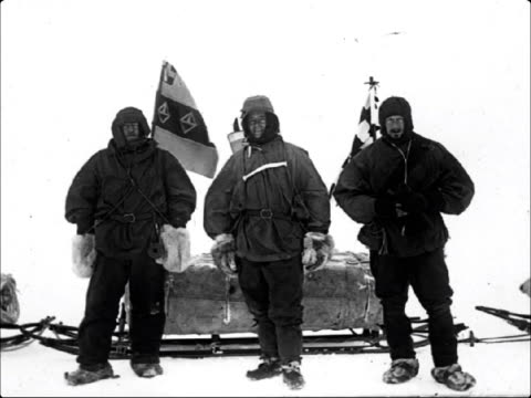 mars lib no b/w still explorer ernest shackleton and colleagues posing beside supply sled in antarctica - ernest shackleton stock videos & royalty-free footage