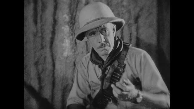 stockvideo's en b-roll-footage met 1925 explorer in cave discovers bones containing engraved pocket watch - ontdekkingsreiziger