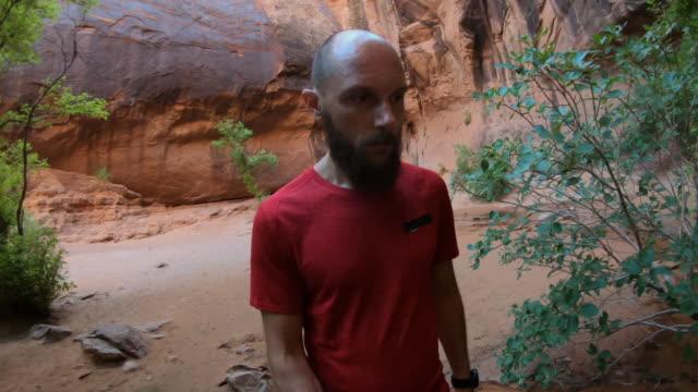 explorer man hiking near canyonlands, moab - geologist stock videos & royalty-free footage