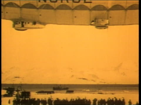 explorer roald amundsen waves from a dirigible as it takes off to explore the north pole - 1926 stock videos & royalty-free footage
