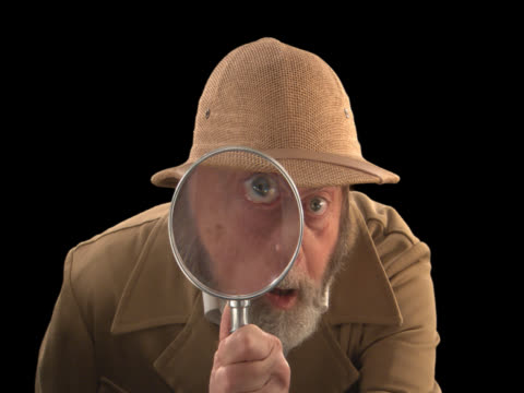 explorer with magnifying glass--front - this clip has an embedded alpha-channel - magnifying glass stock videos & royalty-free footage