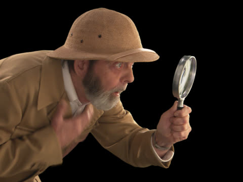 explorer with magnifying glass--profile - this clip has an embedded alpha-channel - pre matted stock videos & royalty-free footage