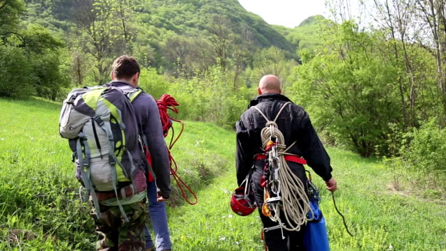 explorers hiking and going to climb mountain top - exhaustion stock videos & royalty-free footage