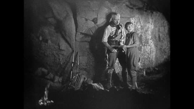 1925 explorers in cave watch smoking volcano - 1925 stock videos & royalty-free footage