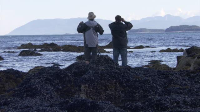 explorers look through binoculars. - binoculars stock videos & royalty-free footage