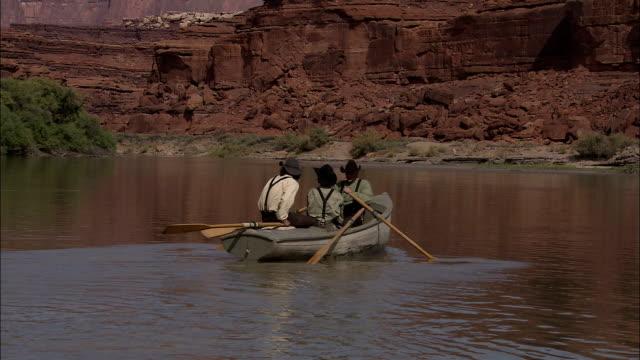 explorers paddle across a river. - historische szene stock-videos und b-roll-filmmaterial