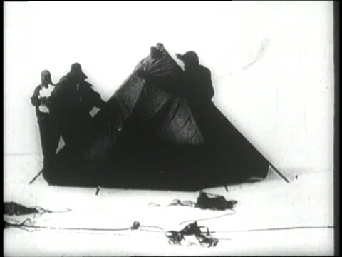 explorers robert falcon scott henry r bowers edgar evans lawrence oates and edward wilson set up a tent and start unpacking supplies inside during an... - antarctica people stock videos & royalty-free footage
