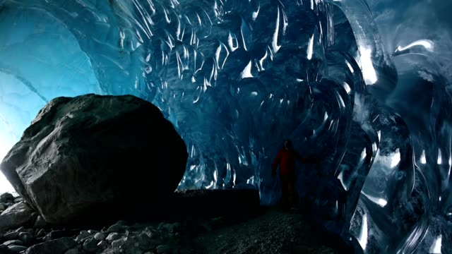 exploring an ancient glacial ice cave - exploration video stock e b–roll