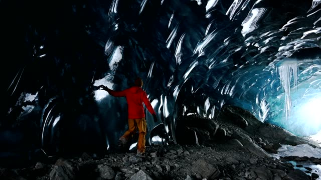 exploring an ancient glacial ice cave - ice stock videos & royalty-free footage
