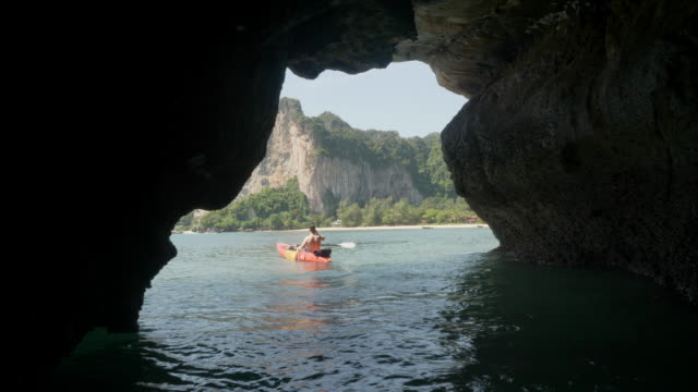 4k uhd: exploring caves in kayaks - kayaking stock videos & royalty-free footage